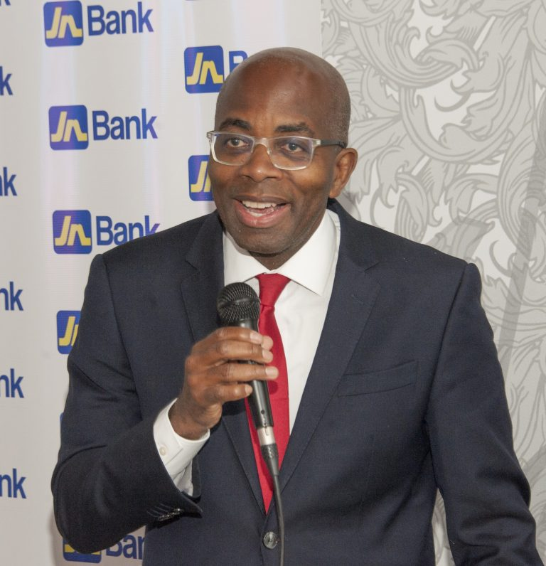 Curtis Martin, managing director, JN Bank addressing a group of Jamaican professionals and business owners at JN Bank's Representative Office in Florida in June.